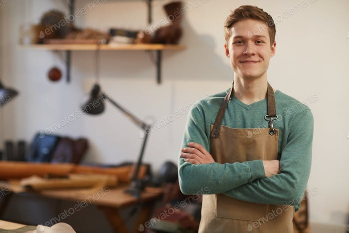 Cheerful Craftsman With Arms Crossed