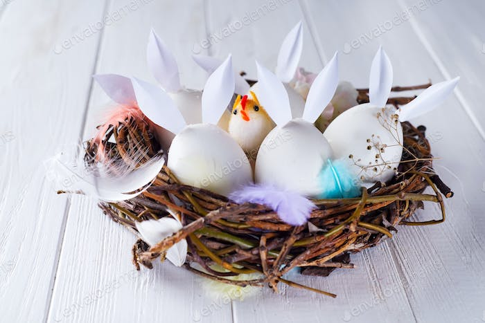 Colorful easter eggs with bunny ears in the nest