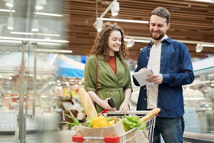 Smiling Couple Shopping in Supermarket