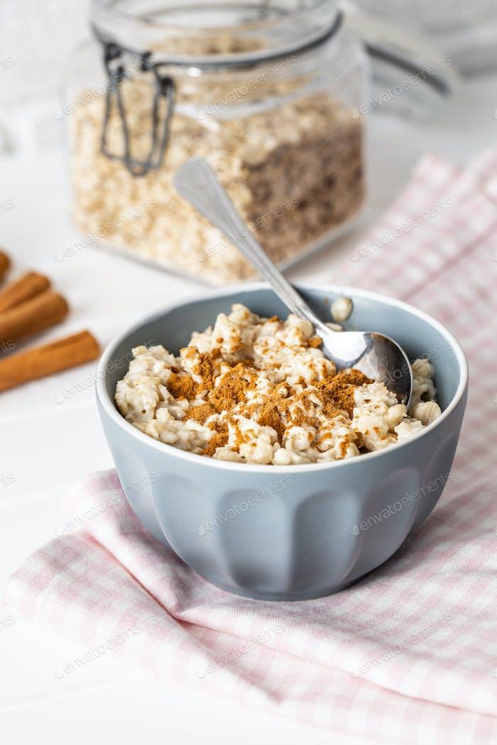 Bowl of oatmeal porridge with cinnamon.
