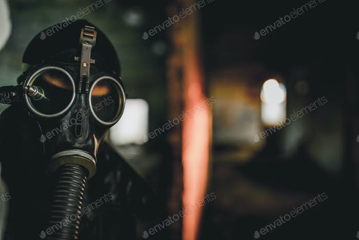 Man wearing protective gas mask for covid,covid19 and nuclear  prevention. Film look and dark tones.