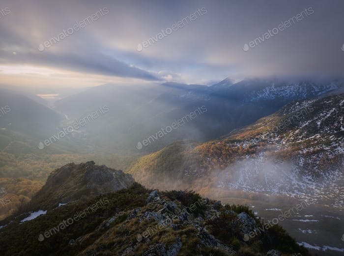 Dawn between mists and low clouds on the summit