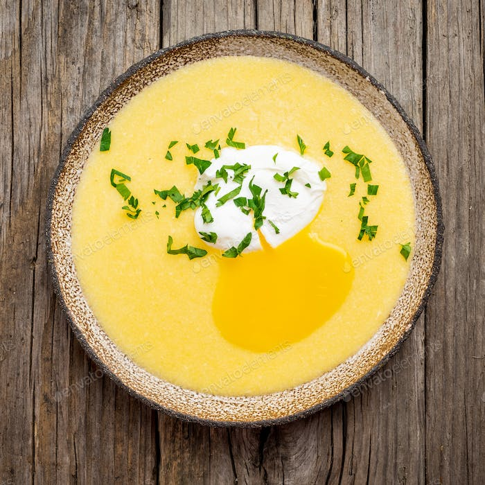 Polenta, porridge with Parmesan cheese and poached egg,