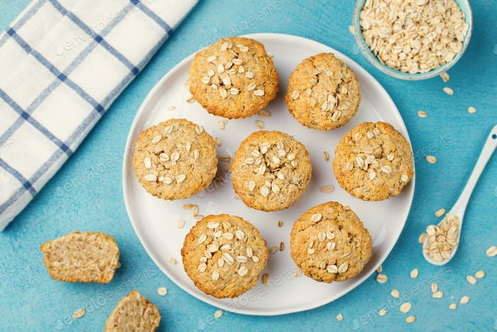 Healthy vegan oat muffins, apple and banana cakes on a white plate Top view