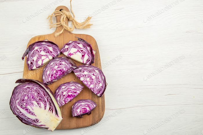 top view chopped red cabbage on chopping board on grey table with free space