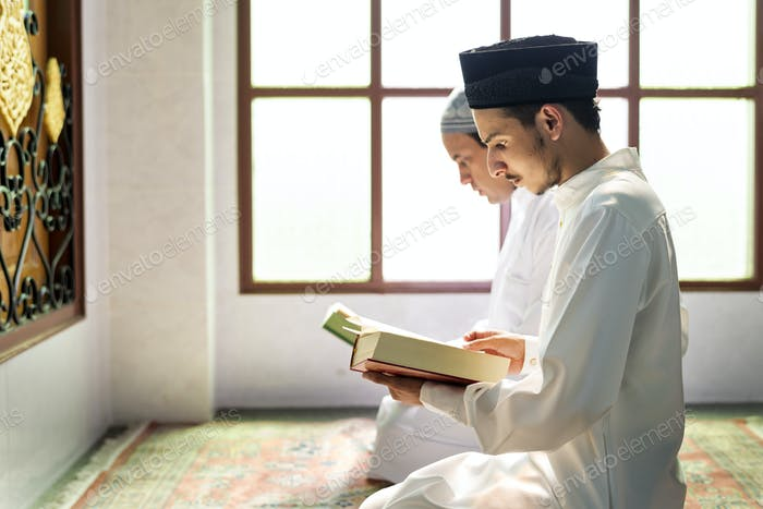 Muslims reading from the quran