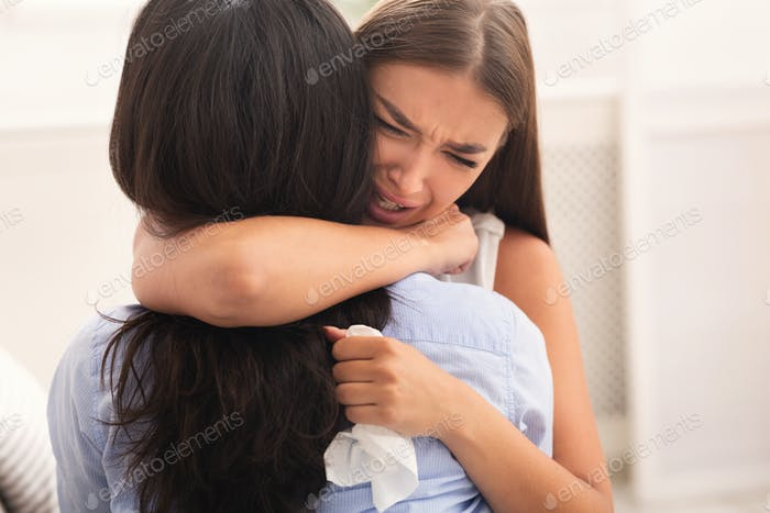 Girl Hugging Crying Friend Comforting Her After Breakup Indoor