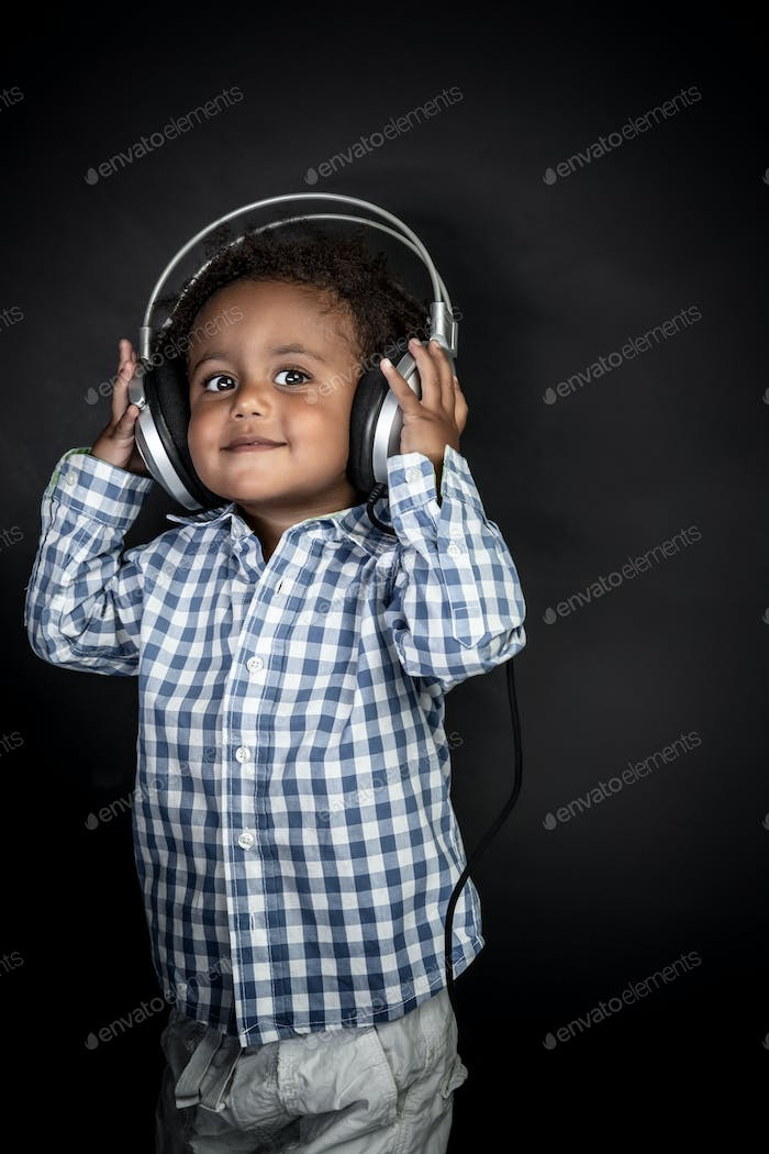Little boy listens music