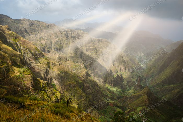 Sun rays coming through the clouds in rocky mountain landscape of in Xo-xo valley in Santo Antao