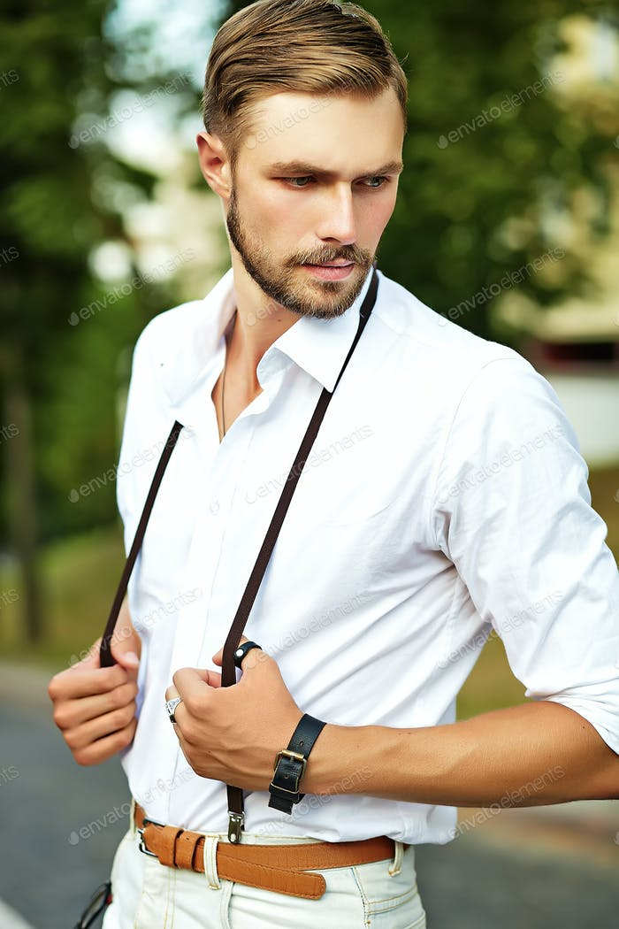 Portrait of handsome man posing in the street