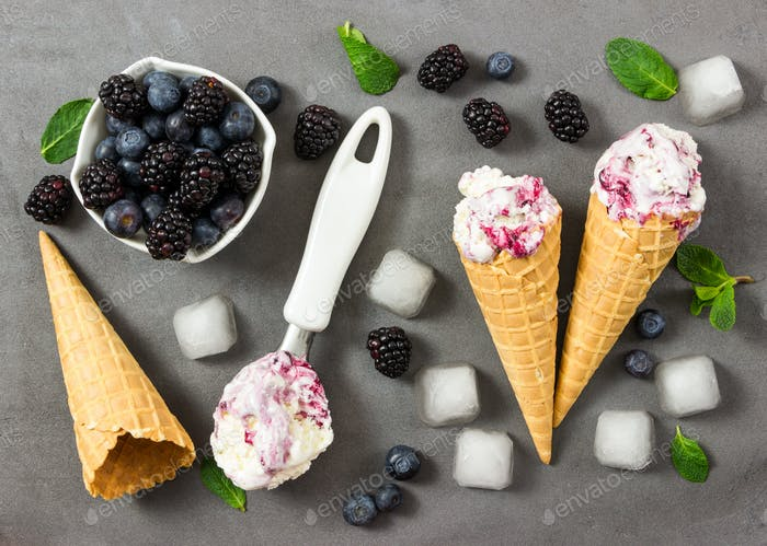Fruit ice cream with fresh blackberry and blueberry, ice cubes a