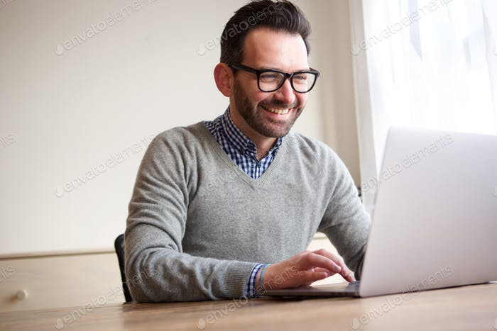 happy businessman working with laptop computer