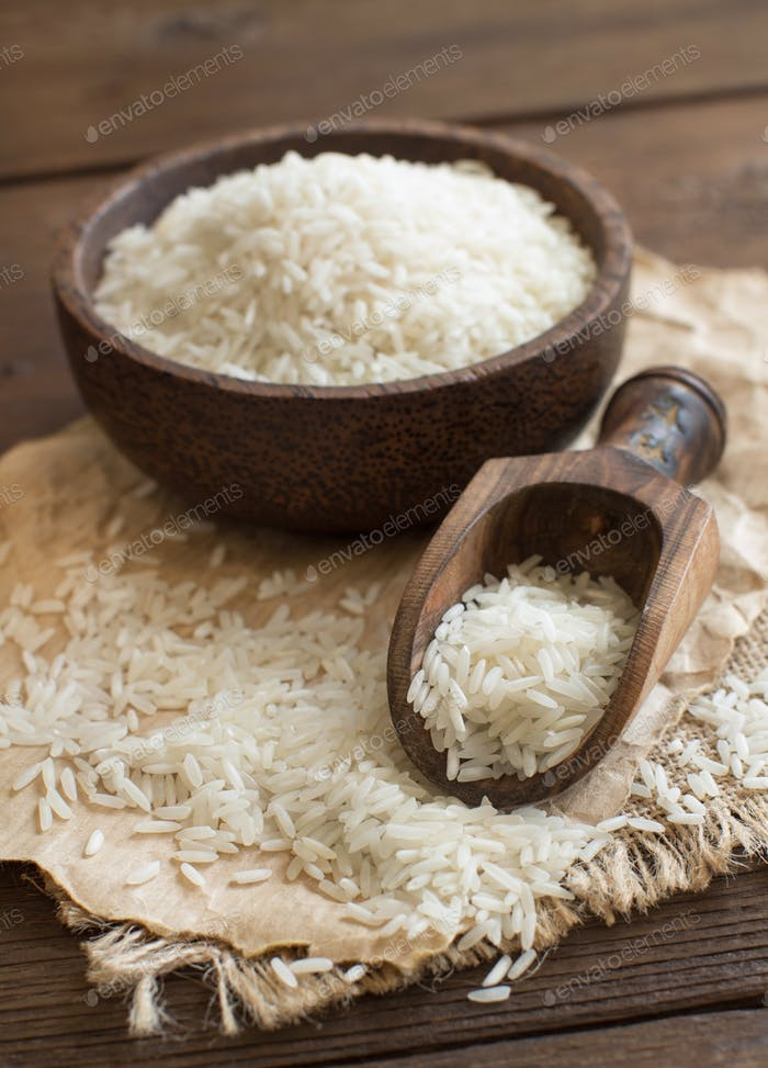 Pile of Basmati rice in a bowl with a spoon