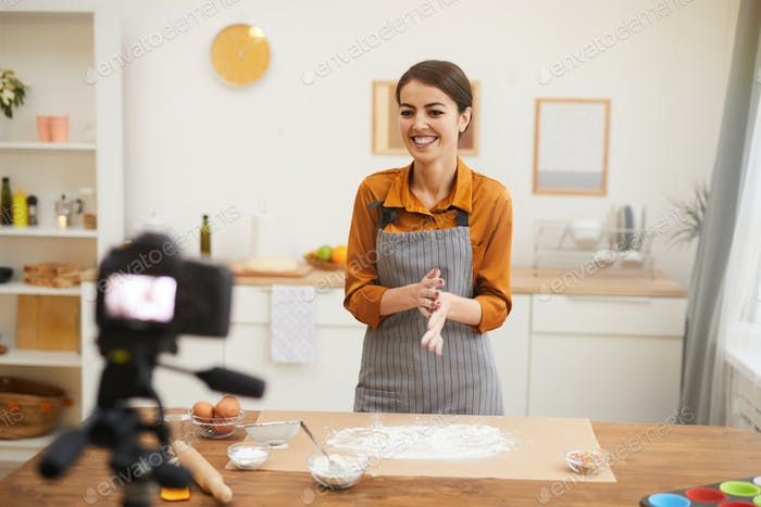 Joyful Woman Filming Baking Video in Kitchen