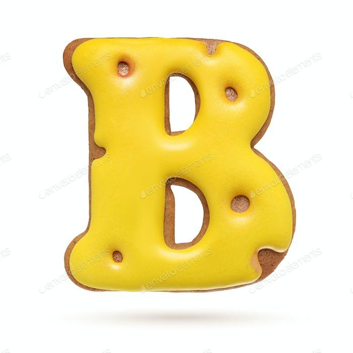 Großbuchstabe B gelber Lebkuchenkeks isoliert auf weiß.