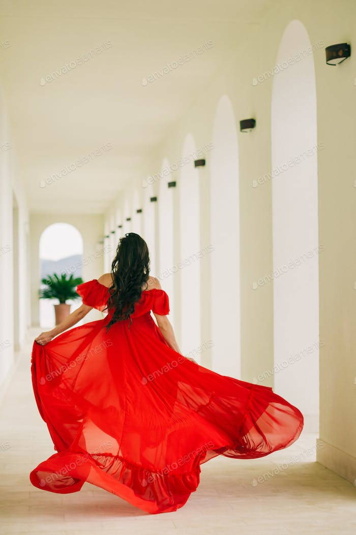 beautiful woman walk in dress