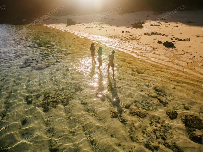 Female friends enjoying summer holidays on tropical beach