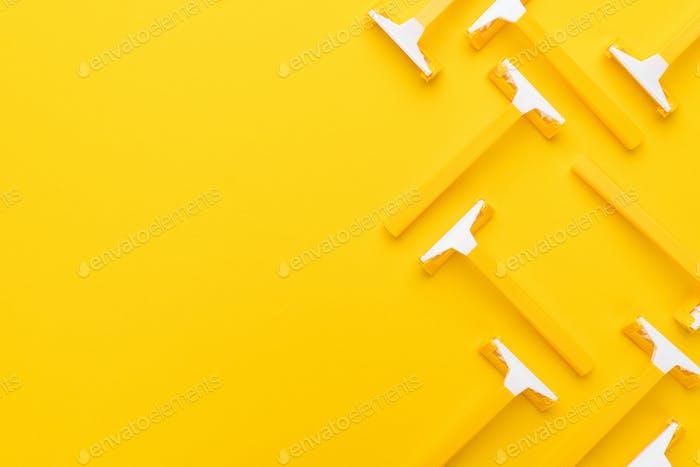 Razors On Yellow Background