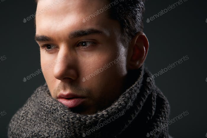 Attractive young man with gray wool scarf