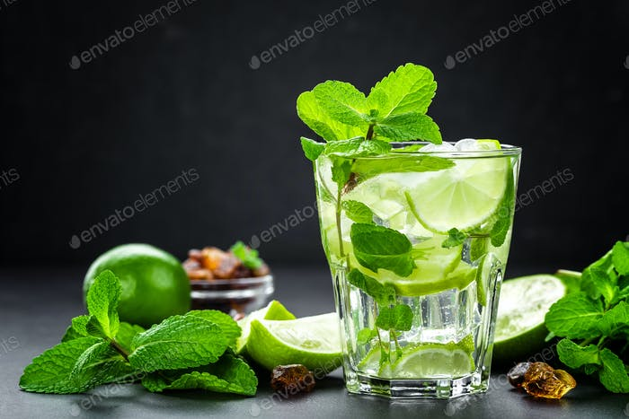 Mojito Cubano or caipirinha cocktail, iced drink with lime and mint