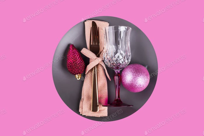 Christmas pink flat lay with festive tableware