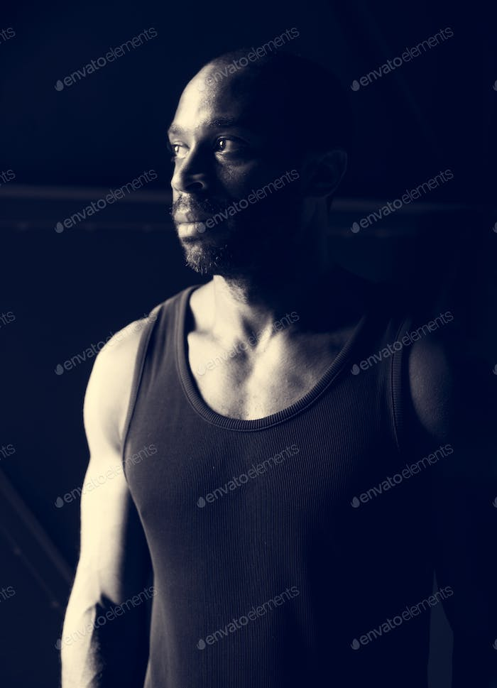 African ethnicity man with thoughtful face expression grayscale