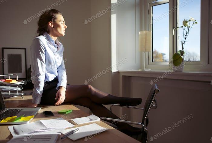 Pretty businesswoman enjoying the sun