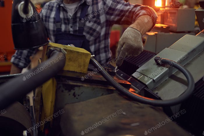 Repairman working with lathe