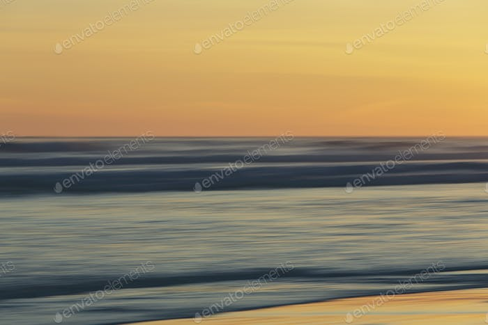 View from the beach over the ocean at sunset, long exposure