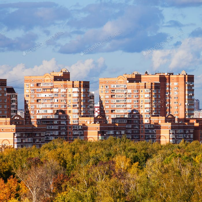 apartment houses in living urban quarter in autumn