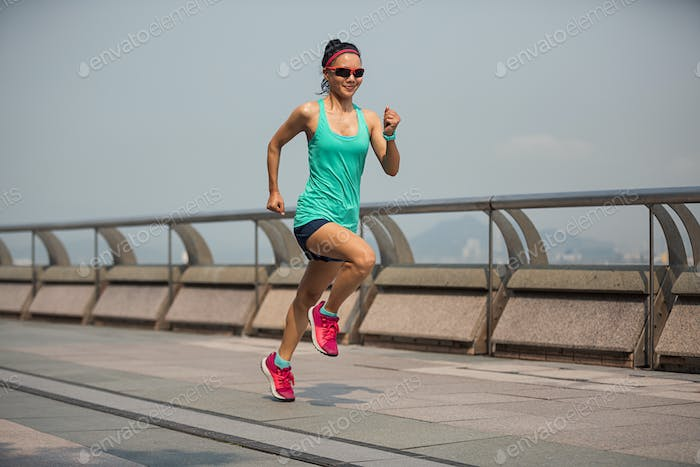 Confidence sports woman running in Hong Kong