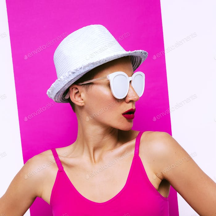 Stylish Girl in sunglasses and hat. Minimal pop art beach fashio