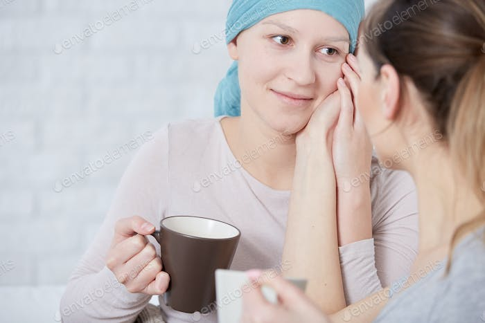 Woman with cancer meeting with friend
