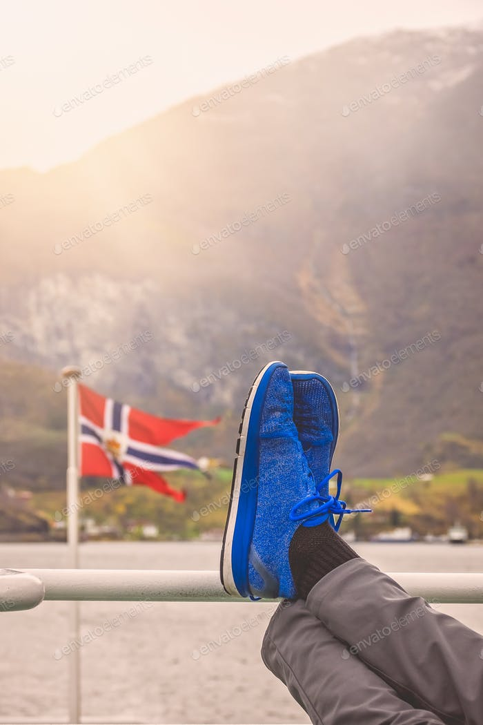 Tourist relaxing during fjord cruise tour in Norway