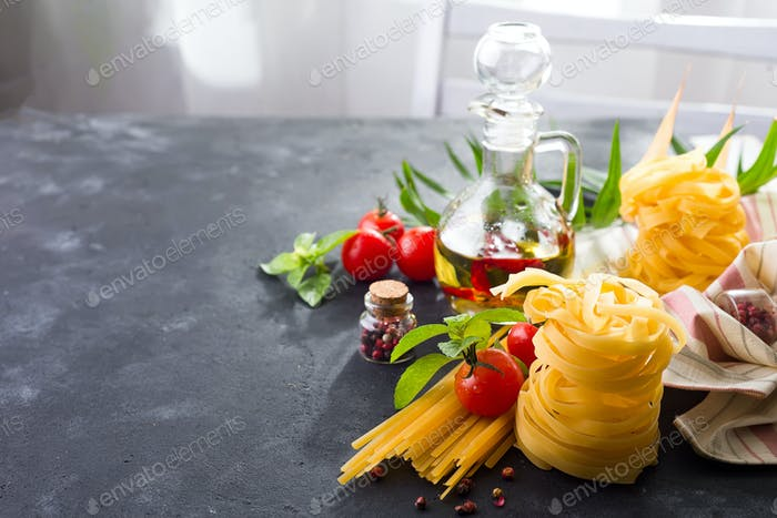 Pasta ingredients. Cherry-tomatoes, spaghetti pasta, basil and spices