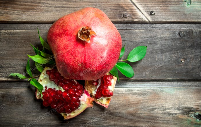 Juicy pomegranate with leaves.