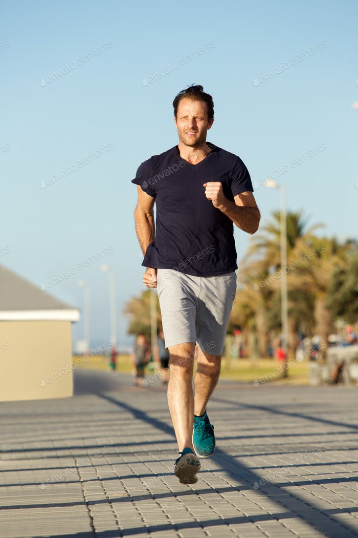 Full body healthy man running outdoors