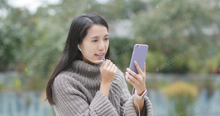 Woman making live stream on cellphone