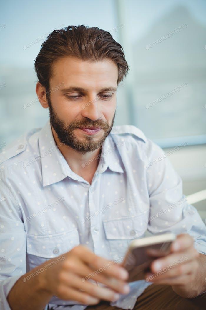 Executive using mobile phone