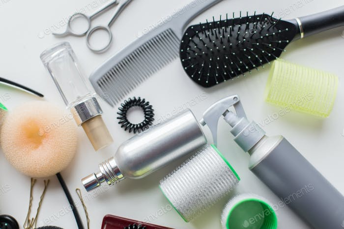 hair brush, styling sprays, curlers and pins