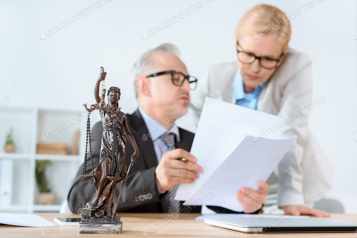 serious mature lawyers working together in modern office
