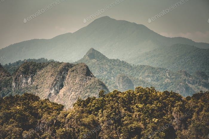 Thailand autumn forest aerial: mountains ranges with jungle. Exotic deciduous trees on hills at Asia
