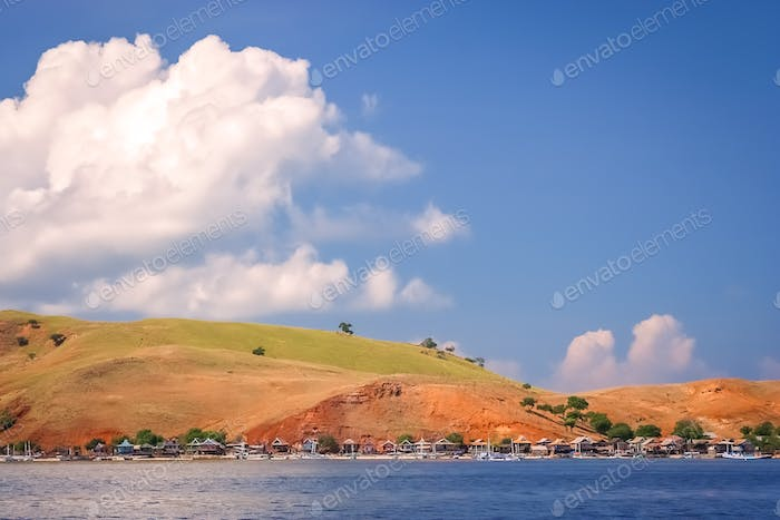 Small huts on the shore of the Komodo island