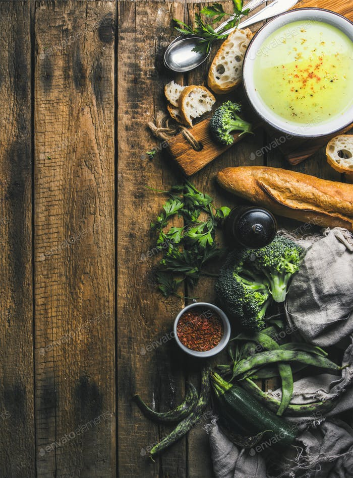 Homemade pea, broccoli, zucchini cream soup with bread, copy space