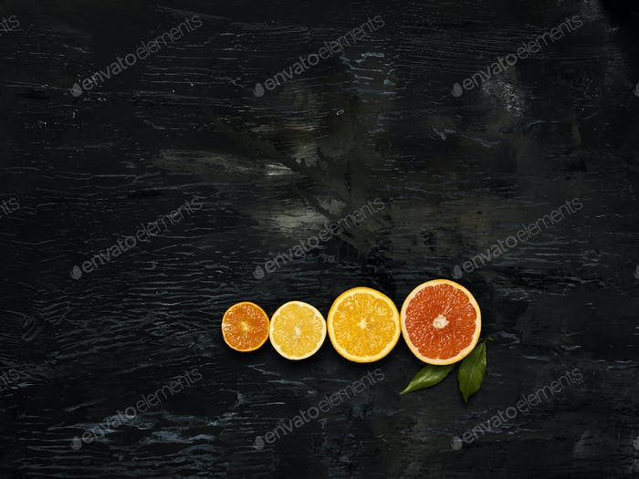 The group fresh fruits against black background