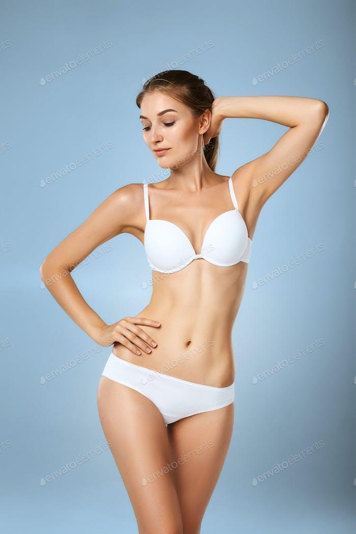 Slim tanned woman in underwear