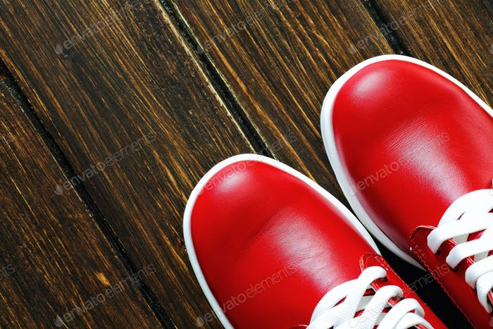red shoes on wooden background