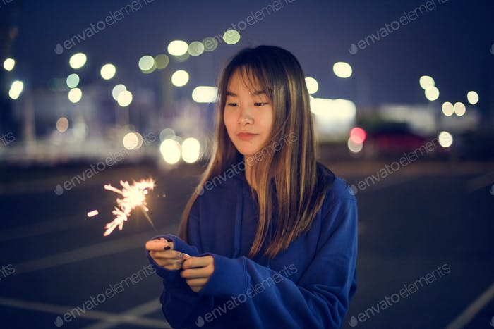 Woman happiness and playing firework