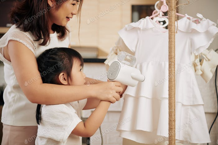 Mother and daughter steaming dress