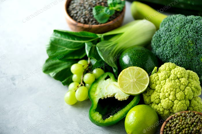 Organic green vegetables and fruits on grey background. Copy space, flat lay, top view. Green apple